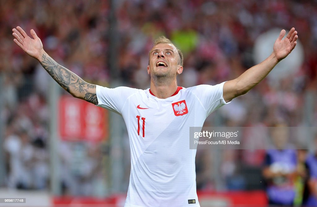Kamil Grosicki of Poland celebrates a goal scored by Piotr Zielinski of Poland during International Friendly match between Poland and Chile on June 8, 2018 in Poznan, Poland.