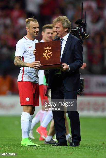 Kamil Grosicki of Poland received a reward after 50th international match from Zbigniew Boniek during the 2018 FIFA World Cup Russia eliminations...