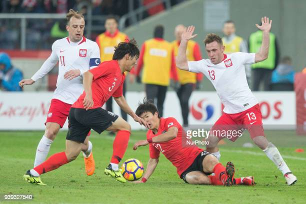 Kamil Grosicki of Poland vies Chul-soon Choi , Chang-hoon Kwon , Maciej Rybus of Poland during the international friendly soccer match between Poland...
