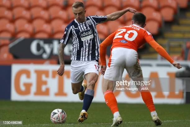 Kamil Grosicki of West Bromwich Albion and Ollie Turton of Blackpool during the FA Cup Third Round match between Blackpool and West Bromwich Albion...
