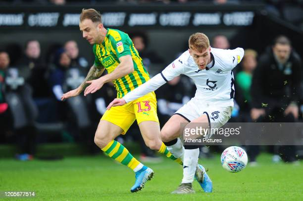 Kamil Grosicki of West Bromwich Albion battles with Jay Fulton of Swansea City during the Sky Bet Championship match between Swansea City and West...