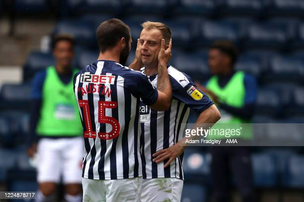 Kamil Grosicki of West Bromwich Albion celebrates after scoring a goal to make it 3-2 with Charlie Austin during the Sky Bet Championship match...