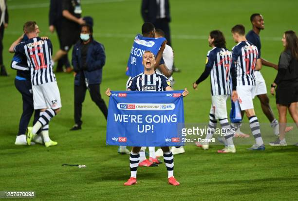 Kamil Grosicki of West Bromwich Albion celebrates promotion after during the Sky Bet Championship match between West Bromwich Albion and Queens Park...