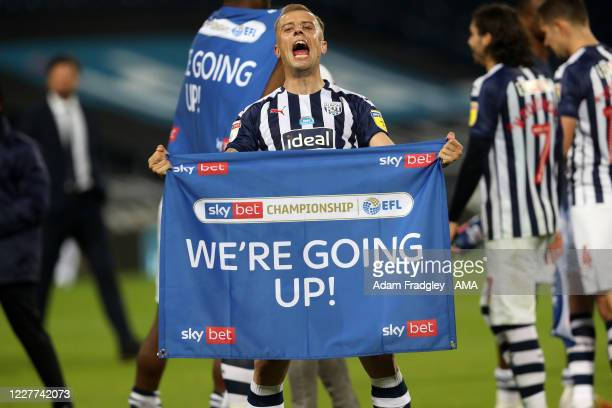 Kamil Grosicki of West Bromwich Albion celebrates promotion to the Premier League on the pitch at the end of the Sky Bet Championship match between...