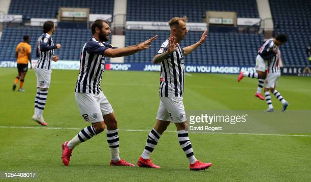 Kamil Grosicki of West Bromwich Albion celebrates with team mate Charlie Austin after scoring their third goal during the Sky Bet Championship match...