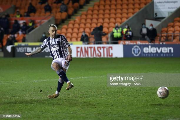 Kamil Grosicki of West Bromwich Albion takes and scores the first penalty during the FA Cup Third Round match between Blackpool and West Bromwich...