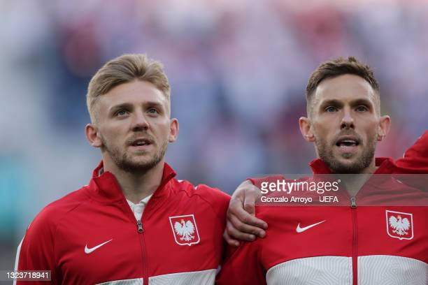 Kamil Jozwiak and his teammate Maciej Rybus of Poland sing their national anthem prior to start during the UEFA Euro 2020 Championship Group E match...