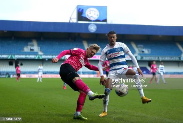 Kamil Jozwiak of Derby County and Niko Hamalainen of Queens Park Rangers in action during the Sky Bet Championship match between Queens Park Rangers...