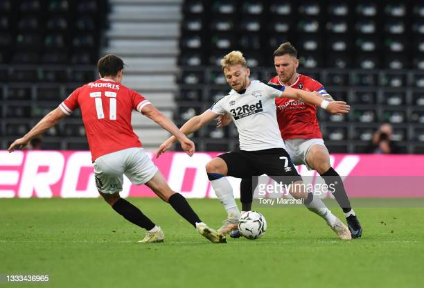 Kamil Jozwiak of Derby County is challenged by Ashley Eastham of Salford City during the Carabao Cup First Round match between Derby County and...