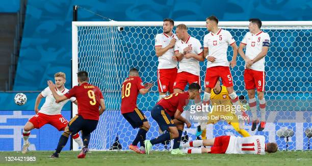 Kamil Jozwiak of Poland attempts to block a free kick by Gerard Moreno of Spain during the UEFA Euro 2020 Championship Group E match between Spain...