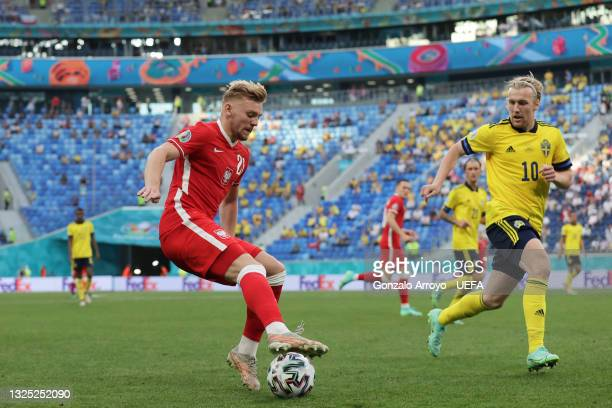 Kamil Jozwiak of Poland competes for the ball with Emil Forsberg of Sweden during the UEFA Euro 2020 Championship Group E match between Sweden and...