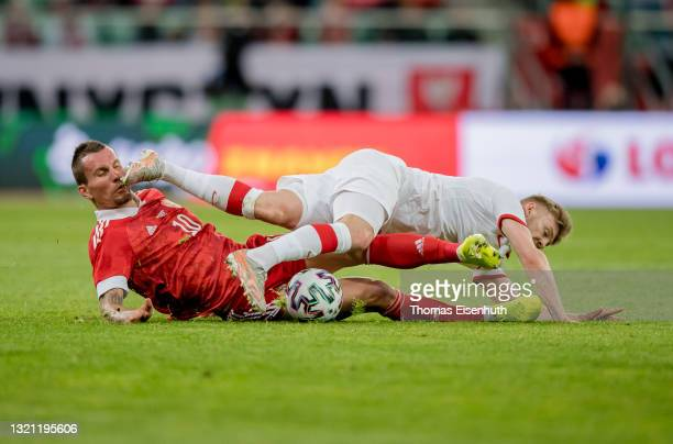 Kamil Jozwiak of Poland in action with Anton Zabolotnyi of Russia during the international friendly match between Poland and Russia at the Municipal...