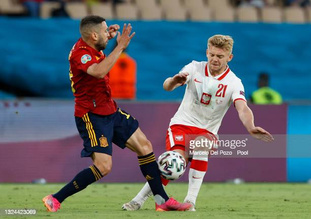 Kamil Jozwiak of Poland is challenged by Jordi Alba of Spain during the UEFA Euro 2020 Championship Group E match between Spain and Poland at Estadio...