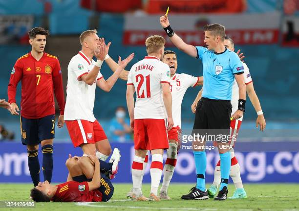 Kamil Jozwiak of Poland is shown a yellow card by Match Referee, Daniele Orsato as he awards Spain a penalty during the UEFA Euro 2020 Championship...