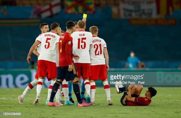 Kamil Jozwiak of Poland is shown a yellow card by Match Referee, Daniele Orsato during the UEFA Euro 2020 Championship Group E match between Spain...