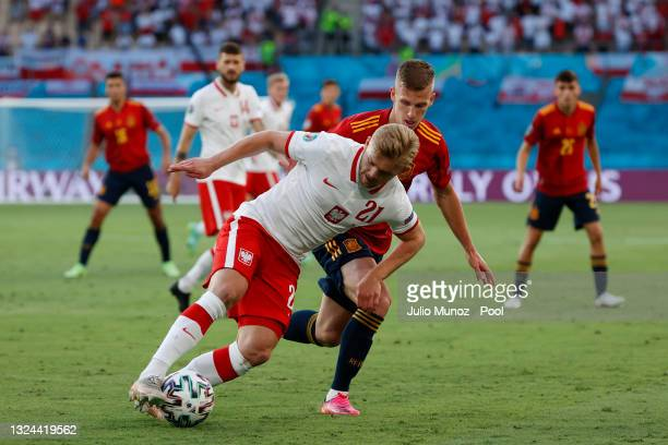 Kamil Jozwiak of Poland runs with the ball whilst under pressure from Dani Olmo of Spain during the UEFA Euro 2020 Championship Group E match between...