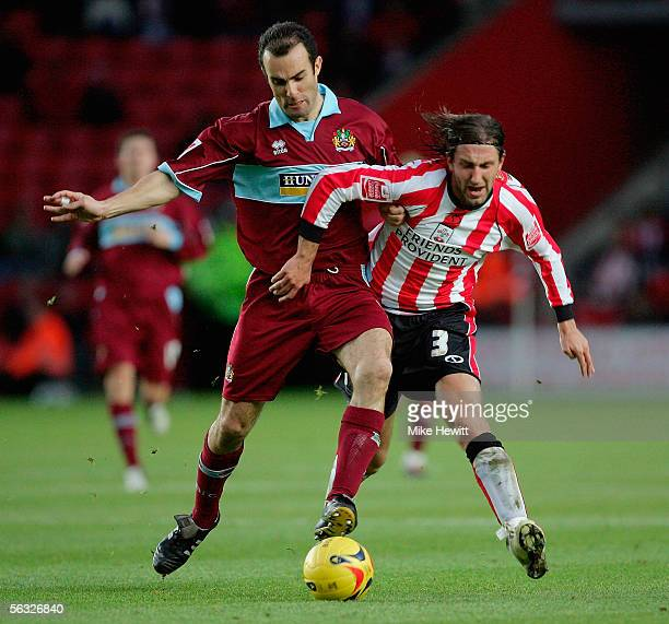 Kamil Kosowski of Southampton is challenged by Graham Branch of Burnley during the CocaCola Championship match between Southampton and Burnley at St...