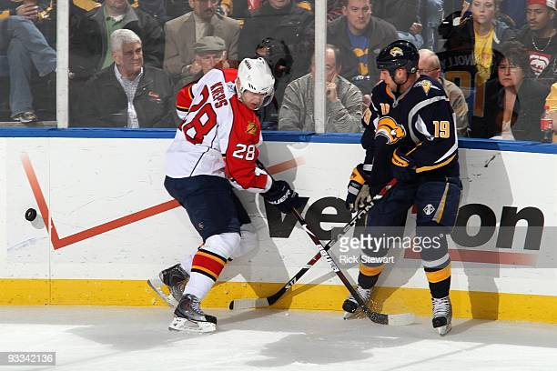 Kamil Kreps of the Florida Panthers battles for the puck against Tim Connolly of the Buffalo Sabres during the game at HSBC Arena on November 18 2009...