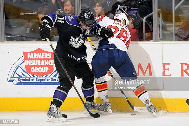 Kamil Kreps of the Florida Panthers fights for the puck against Anze Kopitar of the Los Angeles Kings during the game at Staples Center November 6...