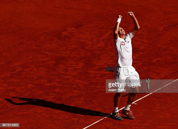 Kamil Majchrzak of Poland celebrates victory after winning the 4th rubber match against Florian Mayer of Germany in the Davis Cup Playoff between...