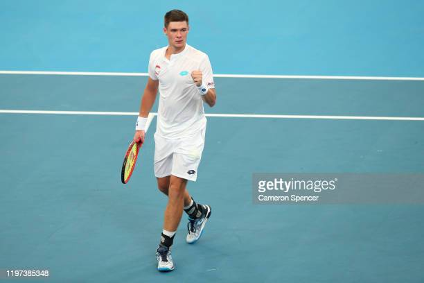 Kamil Majchrzak of Poland celebrates winning set point during his Group E singles match against Guido Pella of Argentina during day two of the 2020...