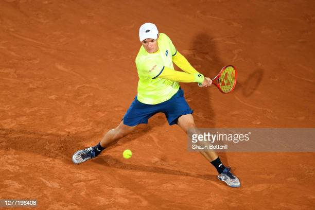 Kamil Majchrzak of Poland plays a backhand during his Men's Singles first round match against Karen Khachanov of Russia on day two of the 2020 French...