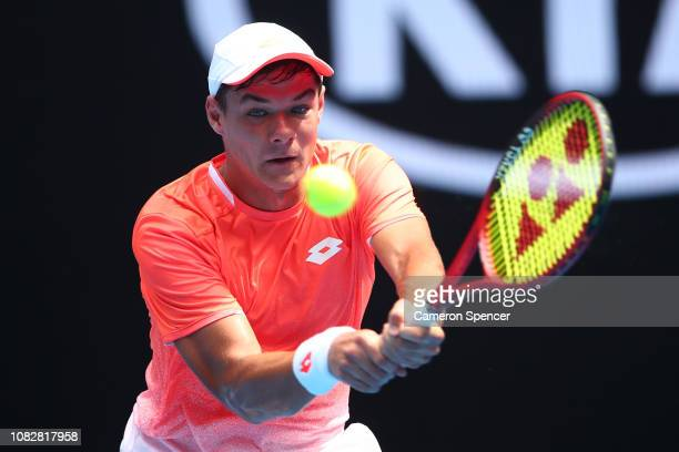 Kamil Majchrzak of Poland plays a backhand in his first round match against Kei Nishikori of Japan during day two of the 2019 Australian Open at...