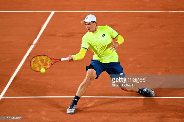 Kamil Majchrzak of Poland plays a forehand during his Men's Singles first round match against Karen Khachanov of Russia on day two of the 2020 French...