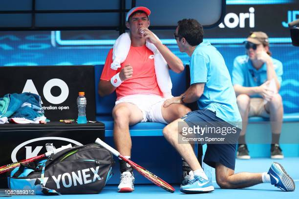 Kamil Majchrzak of Poland receives medical treatment in his first round match against Kei Nishikori of Japan during day two of the 2019 Australian...