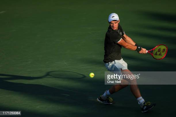 Kamil Majchrzak of Poland returns a shot during his third round Men's Singles match against Grigor Dimitrov of Bulgaria on day five of the 2019 US...