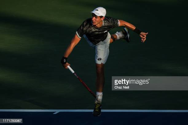 Kamil Majchrzak of Poland serves a shot during his third round Men's Singles match against Grigor Dimitrov of Bulgaria on day five of the 2019 US...