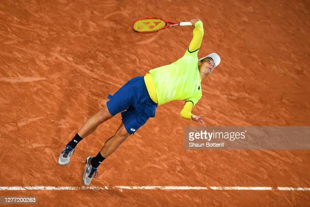 Kamil Majchrzak of Poland serves during his Men's Singles first round match against Karen Khachanov of Russia on day two of the 2020 French Open at...