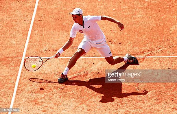 Kamil Majchrzak of Poland slides for a forehand during his match against Florian Mayer of Germany during the 4th rubber of the Davis Cup Playoff...