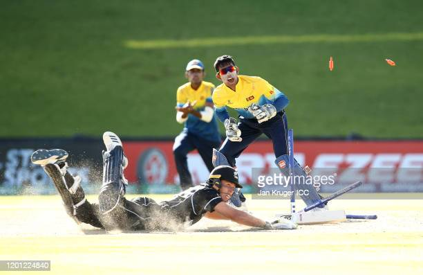 Kamil Mishara of Sri Lanka runs out Simon Keene of New Zealand during the ICC U19 Cricket World Cup Group A match between New Zealand and Sri Lanka...