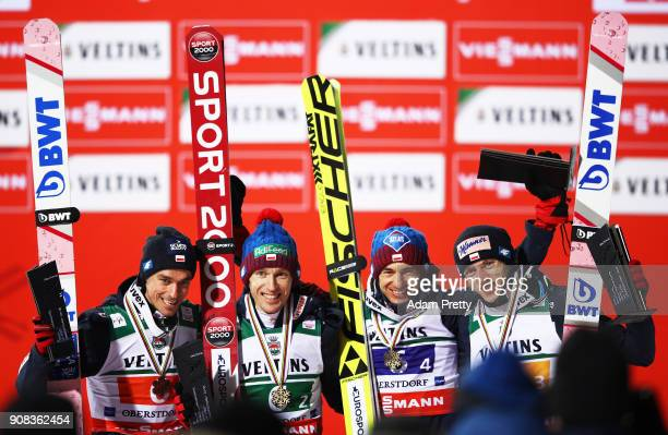 Kamil Stoch Dawid Kubacki Piotr Zyla and Stefan Hula of Poland celebrate winning the bronze medal of the Flying Hill Team competition of the Ski...