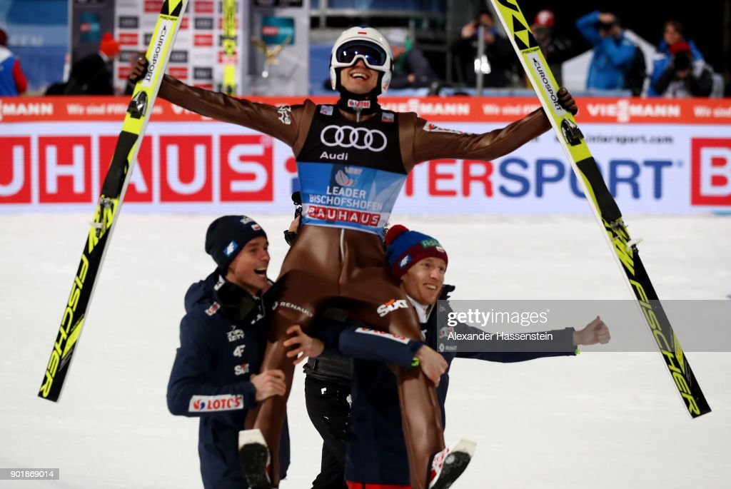 Kamil Stoch of Poland celebrate with his team mates after he wins the FIS Nordic World Cup Four Hills Tournament on January 6, 2018 in Bischofshofen, Austria. Kamil Stoch of Poland, the second ski jumper in history who won all four legs of the Four Hills Tournament