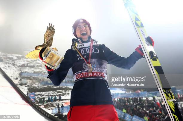 Kamil Stoch of Poland celebrates after he wins the FIS Nordic World Cup Four Hills Tournament on January 6 2018 in Bischofshofen Austria Kamil Stoch...