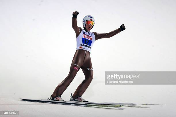 Kamil Stoch of Poland celebrates as he makes the gold medal winning jump during the Men's Team Ski Jumping HS130 at the FIS Nordic World Ski...