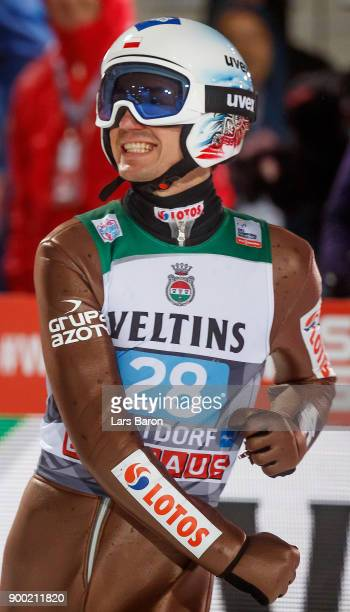 Kamil Stoch of Poland celebrates on day 2 of the FIS Nordic World Cup Four Hills Tournament ski jumping event on December 29 2017 in Oberstdorf...