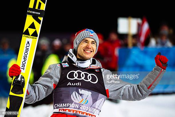 Kamil Stoch of Poland celebrates victory after the final round on Day 2 of the 65th Four Hills Tournament ski jumping event at...