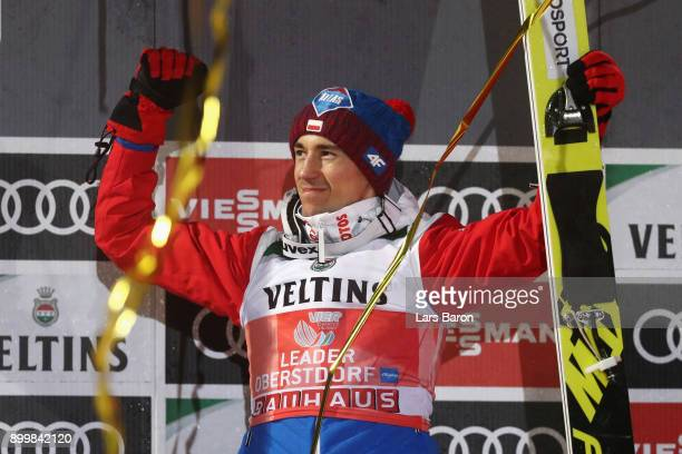 Kamil Stoch of Poland celebrates victory in the FIS Nordic World Cup on day 2 of the Four Hills Tournament ski jumping event on December 30 2017 in...