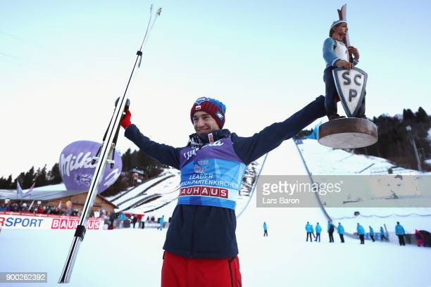 Kamil Stoch of Poland celebrates victory on day 4 of the FIS Nordic World Cup Four Hills Tournament ski jumping event at OlympiaSchanze on January 1...