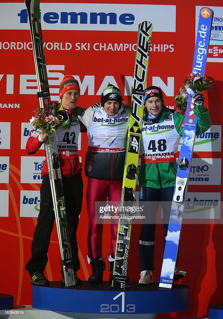Kamil Stoch of Poland celebrates victory with second placed Peter Prevc of Slovenia (L) and third placed Anders Jacobsen of Norway (R) during the Men's Ski Jumping HS134 Final Round at the FIS Nordic World Ski Championships on February 28, 2013 in Val di Fiemme, Italy.