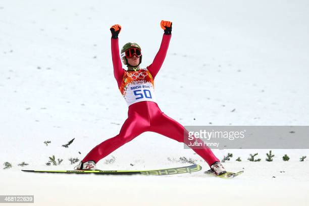 Kamil Stoch of Poland celebrates winning gold after his jump in the Men's Normal Hill Individual Final on day 2 of the Sochi 2014 Winter Olympics at...