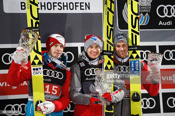 Kamil Stoch of Poland celebrates winning the Bischofshofen competition with Michael Hayboeck of Austria and Piotr Zyla of Poland on Day 2 of the 65th...
