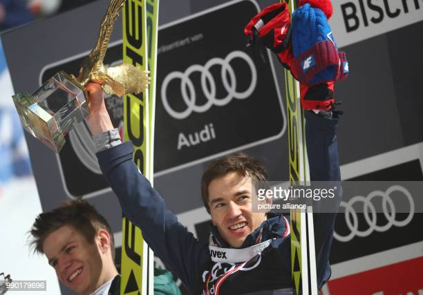 Kamil Stoch of Poland celebrates with Andreas Wellinger of Germany after winning all four jumps at the Four Hills Tournament in Bischofshofen Austria...