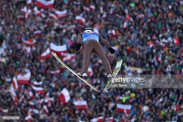 Kamil Stoch of Poland competes at the first round on day 4 of the FIS Nordic World Cup Four Hills Tournament ski jumping event at OlympiaSchanze on...