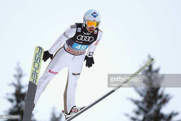 Kamil Stoch of Poland competes at the trail round on Day 2 of the 65th Four Hills Tournament ski jumping event at PaulAusserleitnerSchanze on January...