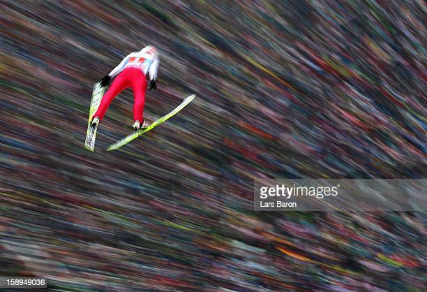 Kamil Stoch of Poland competes during the first round for the FIS Ski Jumping World Cup event of the 61st Four Hills ski jumping tournament at...