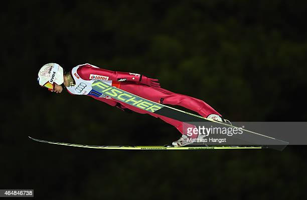 Kamil Stoch of Poland competes during the Men's Team HS134 Large Hill Ski Jumping during the FIS Nordic World Ski Championships at the Lugnet venue...